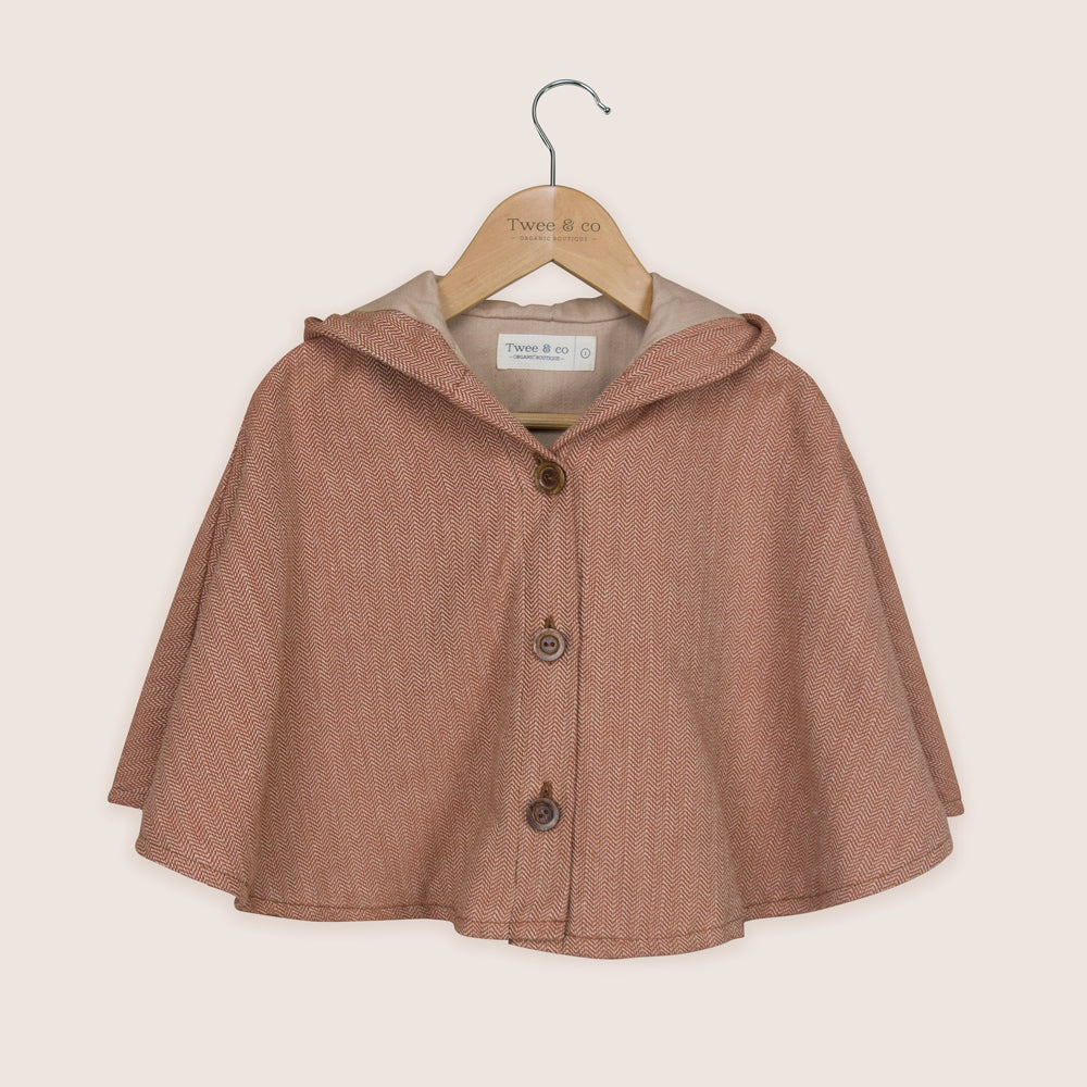 New by Twee & co the Mabel Cape - ginger kiss Made from natural organic cotton fabric and hand crafted by Twee & co Organic baby clothes and organic children's - Made in New Zealand