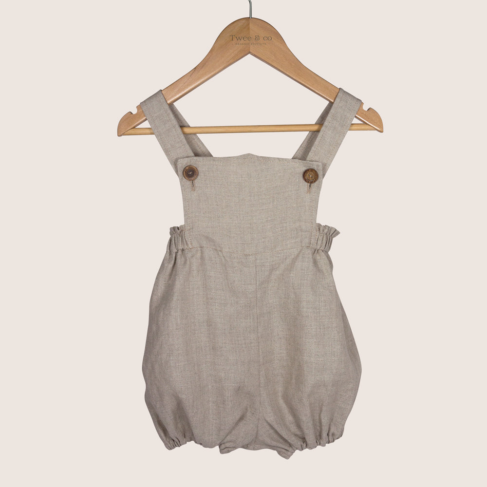 Winnie Romper by Twee & co Organic Boutique is made from organic linen and features non-toxic wooden buttons. Made in New Zealand NZ