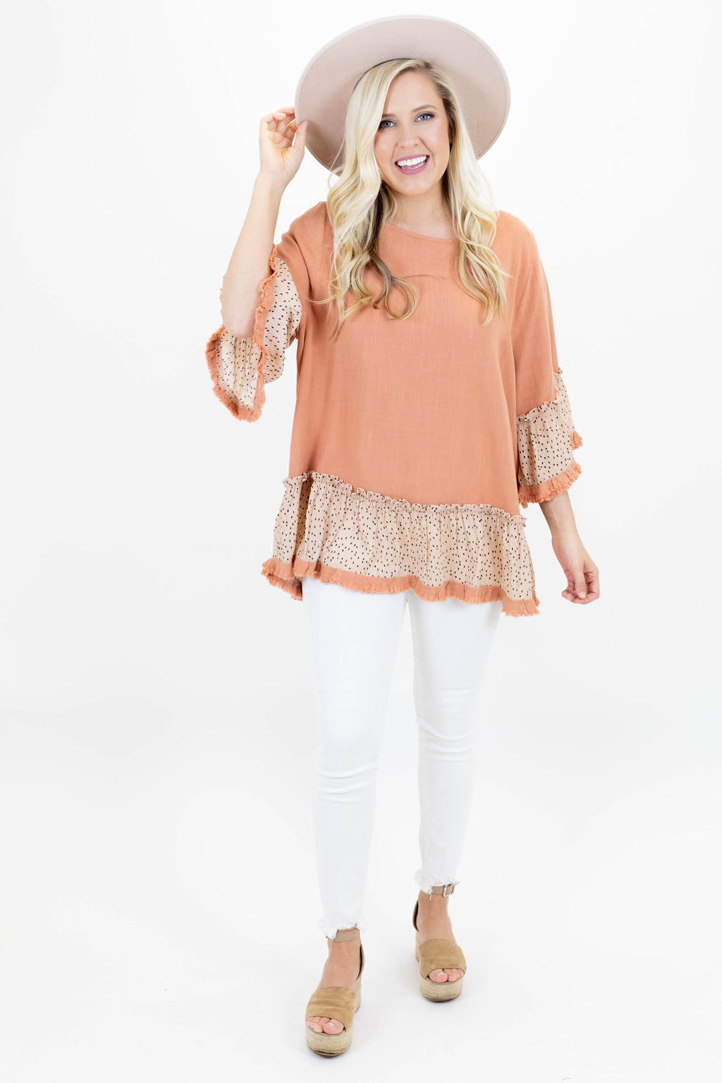Ruffle Tunic with Animal Print Print on the Sleeves and Bottom with 3/4 Length Sleeves
