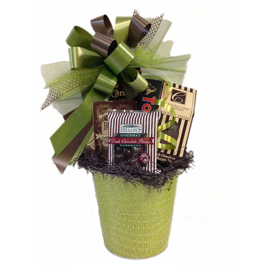 Beautiful, gourmet gift basket full of contents to make your recipient's day.
