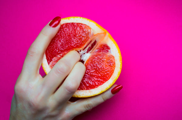 Woman's hand in blood orange