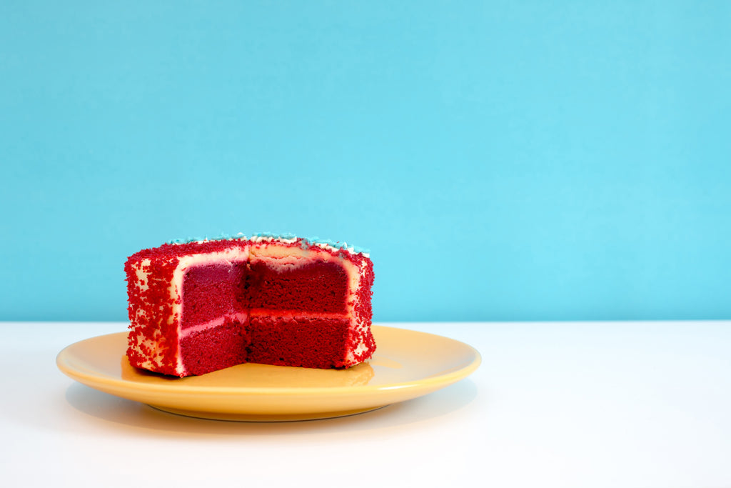 Red velvet cake with a slice missing