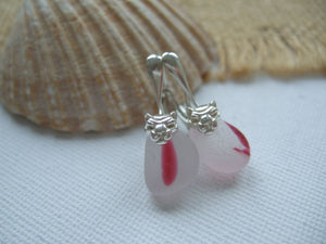 pink lion design earrings with sea glass