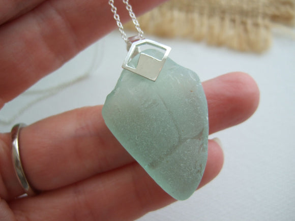 tr letters on coca cola sea glass pendant