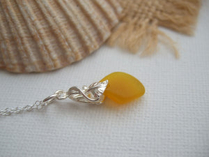 yellow sea glass pendant with flower design setting