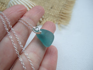 aqua teal sea glass necklace with heart design setting