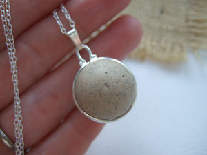 clay marble from the beach set in silver plated band