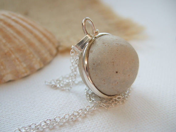 beach found clay marble set in silver plated band