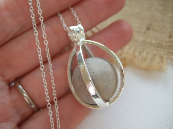 clay beach found marble in locket