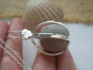 locket with clay marble from the beach