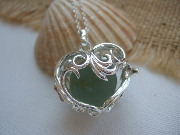 heart shaped locket with large codd sea glass marble