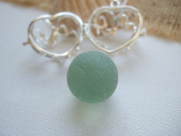 heart shaped locket with codd sea glass marble