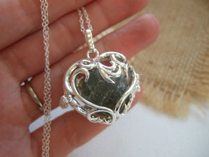very sea worn sea glass marble in heart shaped locket