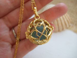gold heart design locket with cats eye sea glass marble