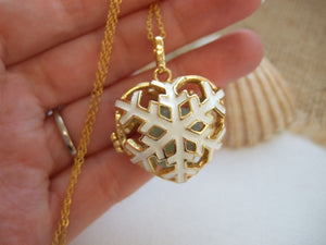 golden snowflake locket with sea glass marble