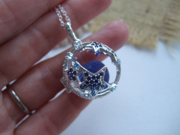 star fish locket with rare blue sea glass marble