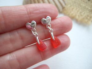 red sea glass studs with heart design