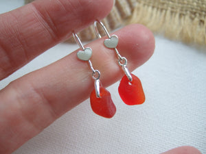 red sea glass earrings with heart settings