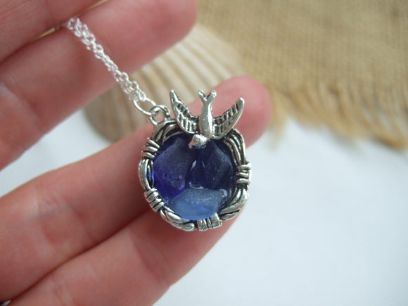 birds nest pendant with sea glass in blue
