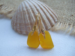 yellow sea glass and gold plated wave earrings