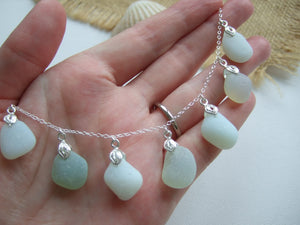 opalescent sea glass necklace with multiple pendants
