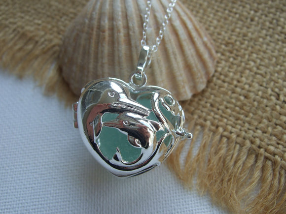 dolphin locket with sea glass marble