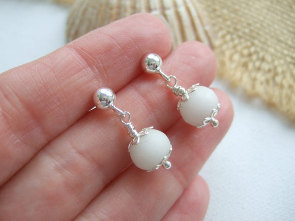 white beach found bead earrings