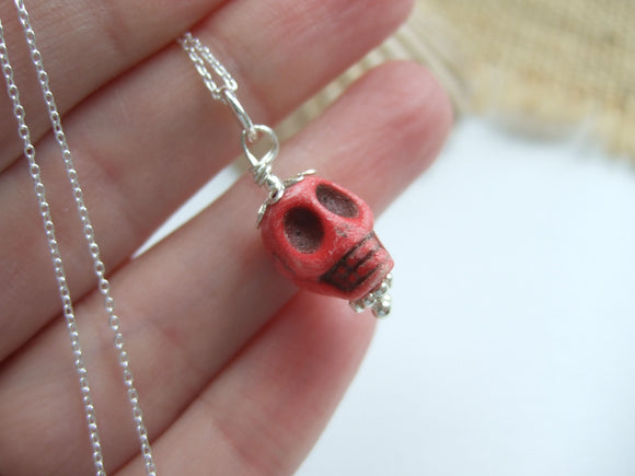 rare skull sea glass bead