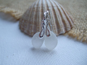 white sea glass and wing design earrings