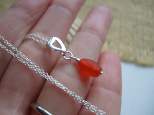 red sea glass bead with heart setting necklace