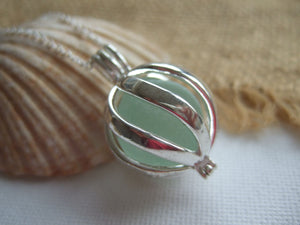 swirl cage locket with sea glass marble