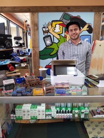 Matt Troetti behind the counter at Never Ever Boards