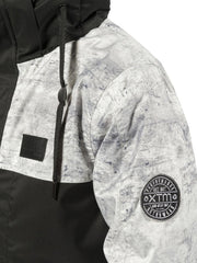 Grey Concrete | XTM Xavier Kids Jacket.  View of the Arm logo. Your Outdoor Store