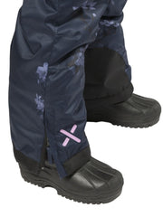 Navy Floral | XTM Akira Kids Snow Suit. Modeled Close up View of the lower leg and ankle with boots on. Your Outdoor Store
