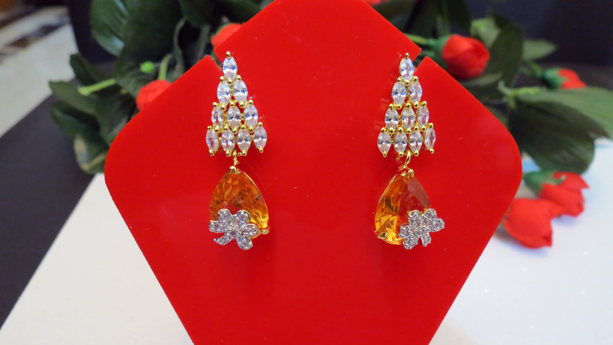 Earings with champagne and zircon