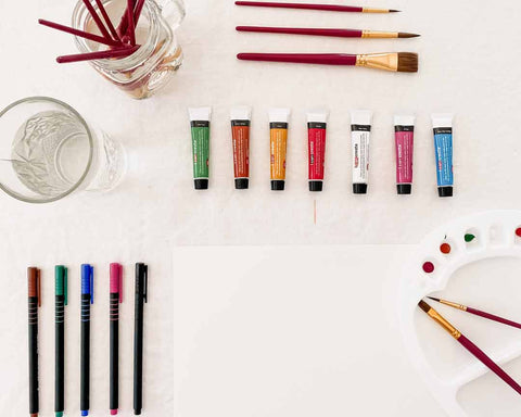 Creative Kids art activity set up with watercolour, fine liners, paper and water palette.