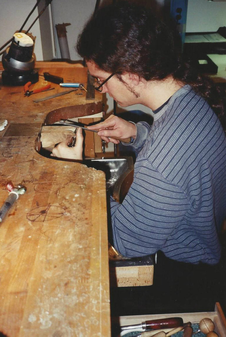Young Todd Reed making jewelry