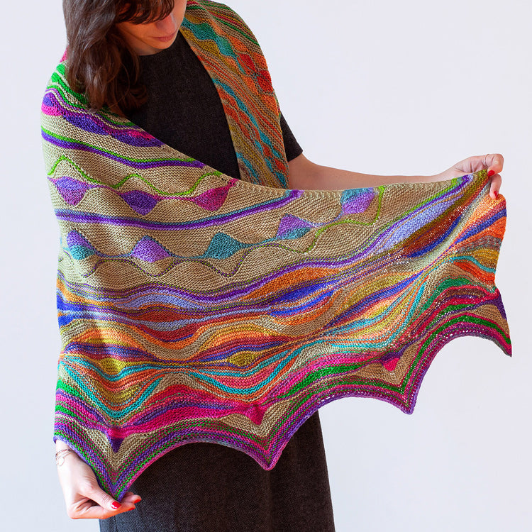 Woman wearing Marin Melchior's Positive Vibrations Shawl knit in Urth Yarn's Uneek & Harvest Fingering