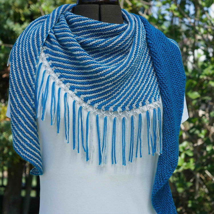 Front view of mannequin wearing Turicum Shawl designed by Ariane Gallizzi knit in fingering/sport yarn