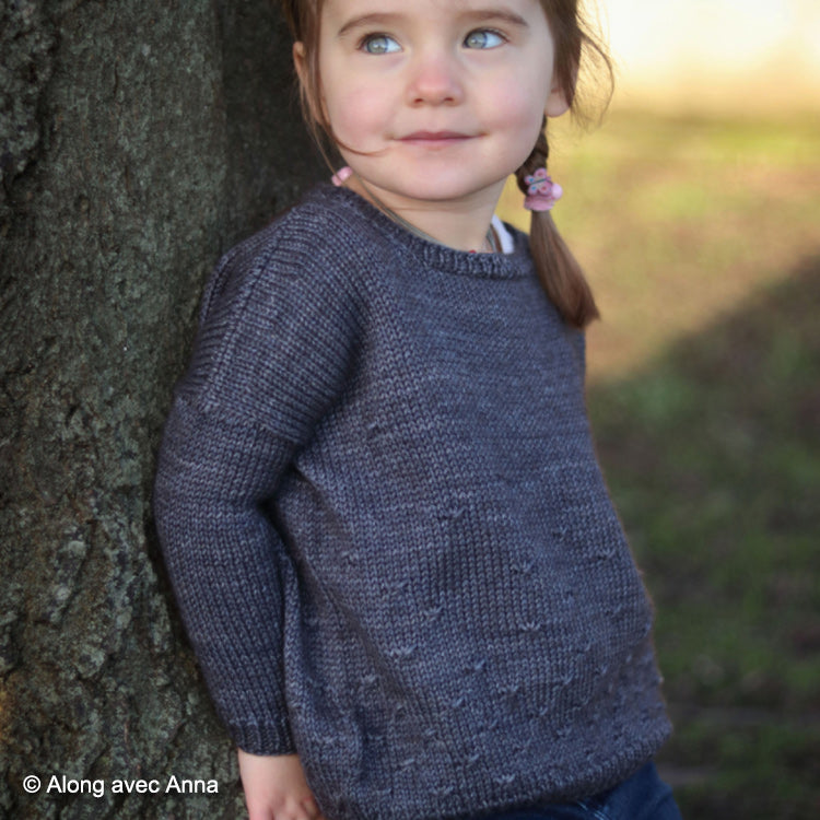 "Toddler wearing Erell (Little) Sweater from ""Along avec Anna"" made with DK weight yarn"