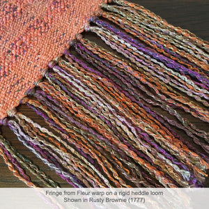 Trendsetter's Fleur Worsted Yarn used in the warp of a woven scarf.