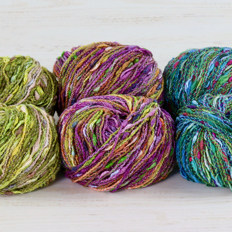 Balls of Trendsetter Yarn's Worsted Cin Cin in various colors