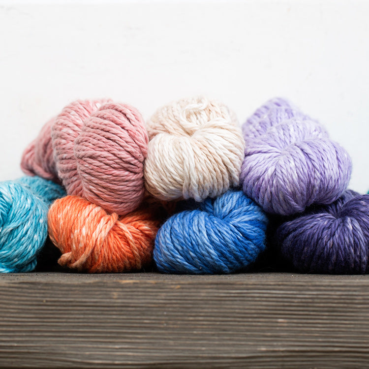 Multiple skeins of Urth Galatea Solids Bulky 100% Cotton Yarn in various colors