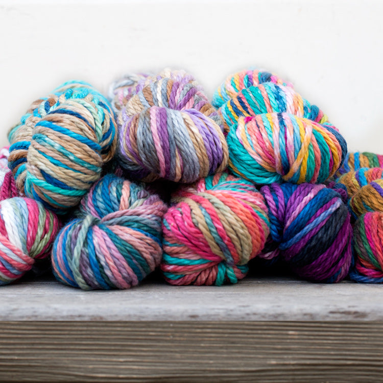 Multiple skeins of Urth Galatea Self-Striping Bulky 100% Cotton Yarn in various colors