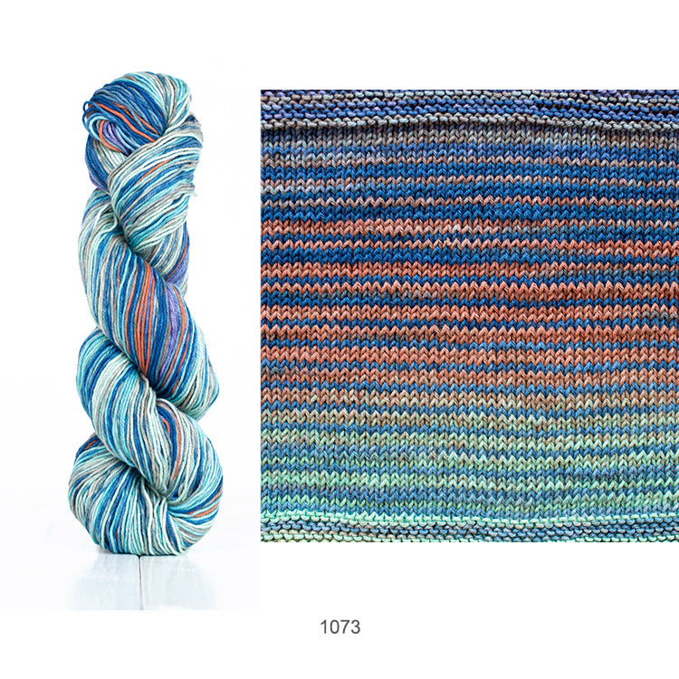 One skein and knit sample of Urth's Uneek Cotton DK yarn in color #1073