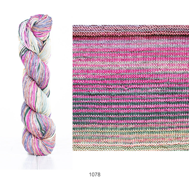 One skein and knit sample of Urth's Uneek Cotton DK yarn in color #1078