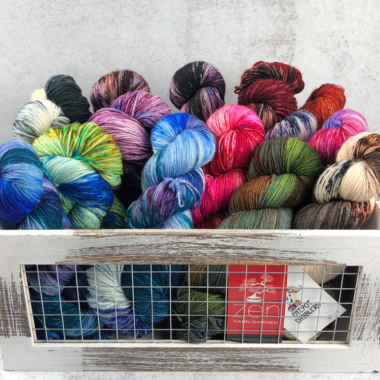 Multiple skeins of Zen Yarn Garden's Superfine Fingering - Dyepot Dabbler Series - in various colors