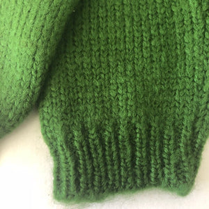 A a pair kids green knitted leg warmers
