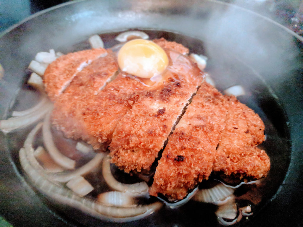 Pork with egg on top