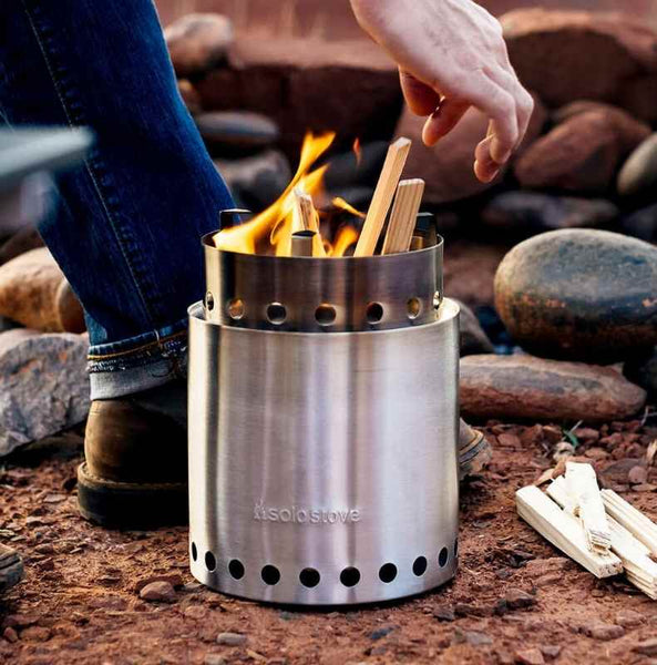 adding kindling to solo stove campfire